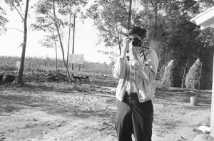 Jim Peppler, photographer for The Southern Courier, in the yard of the Bracy family in Elmore County, Alabama.