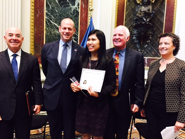 After today's ceremony with newly naturalized US citizen Gina Haller (center, with official certificate).